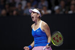 Belinda Bencic of Switzerland reacts after winning the first set against Elina Svitolina of Ukraine during the WTA Finals Tennis Tournament at the Shenzhen Bay Sports Center in Shenzhen, China's Guangdong province, Saturday, Nov. 2, 2019. (AP Photo/Andy Wong)
