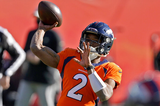 Denver Broncos quarterback Kendall Hinton (2) warms up prior to an NFL football game against the New Orleans Saints, Sunday, Nov. 29, 2020, in Denver. (AP Photo/Jack Dempsey)