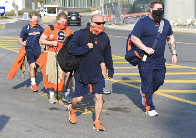 The Syracuse football coaching staff arrive to the Carrier Dome before an NCAA college football game against Duke on Saturday, Oct 10, 2020, at the Carrier Dome in Syracuse, N.Y.  (Dennis Nett/The Post-Standard via AP)