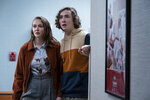 """This image released by Universal Pictures shows Andi Matichak, left, and Dylan Arnold in """"Halloween Kills,"""" directed by David Gordon Green. (Ryan Green/Universal Pictures via AP)"""