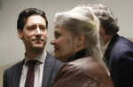 David Daleiden, left, and Sandra Merritt, foreground, wait outside of a courtroom in San Francisco, Monday, Feb. 11, 2019. Planned Parenthood has made an unusual legal demand to join California's criminal prosecution of two anti-abortion activists charged with invasion of privacy for secretly making videos as they tried to buy fetal material from the organization.(AP Photo/Jeff Chiu)
