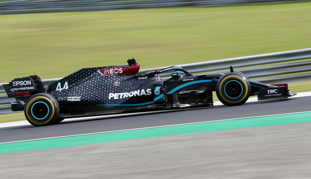 Mercedes driver Lewis Hamilton of Britain steers his car during the Hungarian Formula One Grand Prix at the Hungaroring racetrack in Mogyorod, Hungary, Sunday, July 19, 2020. (AP Photo/Darko Bandic)