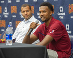 Cleveland Cavaliers first-round draft selection Evan Mobley, right, speaks with reporters as Cavaliers GM Koby Altman listens during a news conference at the NBA basketball team's training facility in Independence, Ohio, Friday, July 30, 2021. (AP Photo/Phil Long)