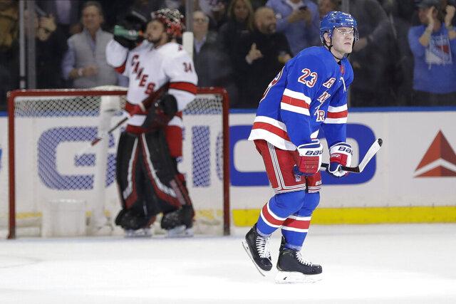 New York Rangers' Adam Fox (23) skates past Carolina Hurricanes goaltender Petr Mrazek (34) after scoring a goal during the first period of an NHL hockey game Wednesday, Nov. 27, 2019, in New York. (AP Photo/Frank Franklin II)