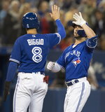 Toronto Blue Jays Randal Grichuk is met at home plate by teammate Cavan Biggio after hitting a three-run home run against the New York Yankees in the fifth inning of a baseball game in Toronto, Sunday, Sept. 15, 2019. (Fred Thornhill/The Canadian Press via AP)
