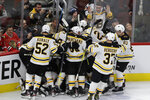 Boston Bruins defenseman Charlie McAvoy (73) celebrates with teammates after scoring against the Chicago Blackhawks during overtime in an NHL hockey game in Chicago, Wednesday, Feb. 5, 2020. The Bruins won 2-1. (AP Photo/Nam Y. Huh)