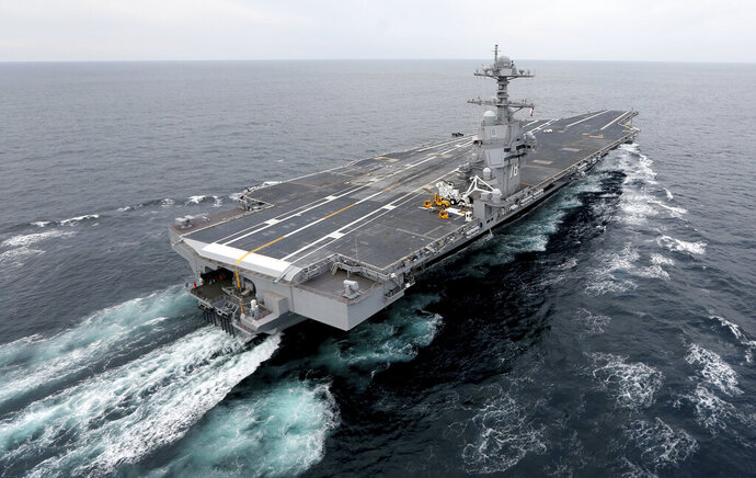File-This Dec. 15, 2017, file photo shows the aircraft carrier Gerald R. Ford. The nation's newest aircraft carrier has headed out to sea for more tests after it underwent a series of upgrades and fixes at a Virginia shipyard. The Navy said in a statement that the USS Gerald R. Ford departed Friday after spending 15 months at Newport News Shipbuilding. (Steve Earley/The Virginian-Pilot via AP, File)