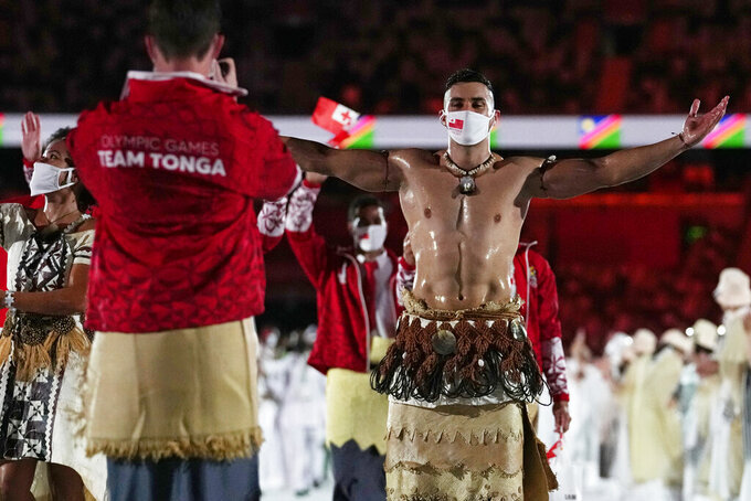 Pita Taufatofua, of Tonga, walks during the opening ceremony in the Olympic Stadium at the 2020 Summer Olympics, Friday, July 23, 2021, in Tokyo, Japan. (AP Photo/Petr David Josek)