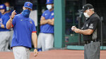 Chicago Cubs manager David Ross, left, argues with home plate umpire Tim Timmons in the fifth inning in a baseball game against the Cleveland Indians, Wednesday, Aug. 12, 2020, in Cleveland. Ross was arguing after Willson Contreras struck out. (AP Photo/Tony Dejak)
