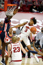 Arkansas guard Desi Sills (3) tries to drive to the hoop against Mississippi during the first half of an NCAA college basketball game Wednesday, Jan. 27, 2021, in Fayetteville, Ark. (AP Photo/Michael Woods)