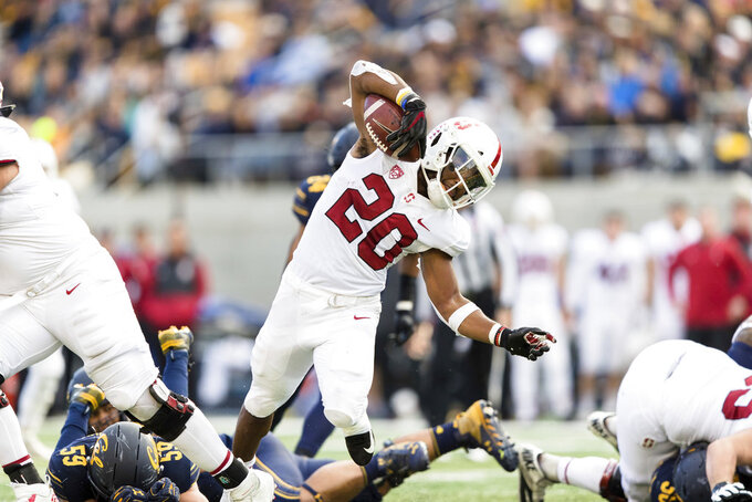 Stanford running back Bryce Love (20) run the ball against California in the fourth quarter of a football game in Berkeley, Calif., Saturday, Dec. 1, 2018. (AP Photo/John Hefti)