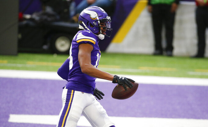 Minnesota Vikings wide receiver Justin Jefferson catches a 12-yard touchdown pass during the first half of an NFL football game against the Carolina Panthers, Sunday, Nov. 29, 2020, in Minneapolis. (AP Photo/Bruce Kluckhohn)