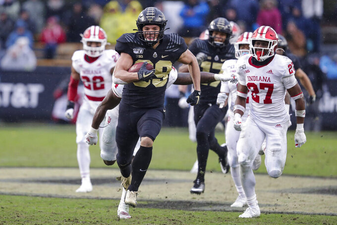 Purdue tight end Brycen Hopkins (89) runs in for a touchdown in front of Indiana defensive back Devon Matthews (27) during the first half of an NCAA college football game in West Lafayette, Ind., Saturday, Nov. 30, 2019. (AP Photo/Michael Conroy)