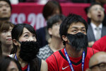 Houston Rockets' James Harden fans with fake beards attend an NBA preseason basketball game between the Houston Rockets and the Toronto Raptors Tuesday, Oct. 8, 2019, in Saitama, near Tokyo. (AP Photo/Jae C. Hong)