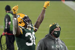 Green Bay Packers' Jamaal Williams celebrates after an NFL divisional playoff football game against the Los Angeles Rams Saturday, Jan. 16, 2021, in Green Bay, Wis. The Packers defeated the Rams 32-18 to advance to the NFC championship game. (AP Photo/Morry Gash)