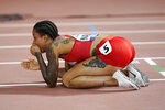 Salwa Eid Naser, of Bahrain, reacts to winning gold in the 400 meter final at the World Athletics Championships in Doha, Qatar, Thursday, Oct. 3, 2019. (AP Photo/David J. Phillip)
