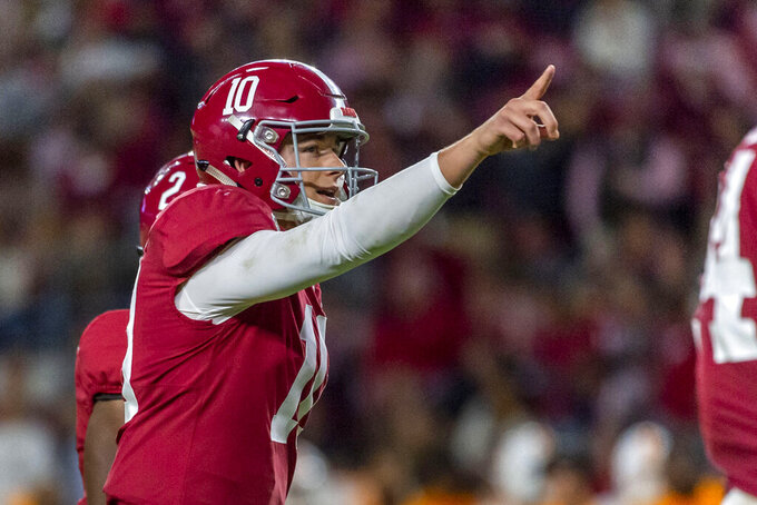 Alabama quarterback Mac Jones signals during the second half of the team's NCAA college football game against Tennessee on Saturday, Oct. 19, 2019, in Tuscaloosa, Ala. (AP Photo/Vasha Hunt)