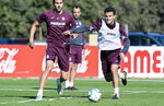 In this photo released by Villarreal Club de Futbol on Tuesday, Oct. 15, 2019, Giuseppe Rossi, right, duels for the ball during a training with Spanish club Villarreal, Spain. Italian-American striker Giuseppe Rossi, who played for the Italian national team before a series of injuries slowed his career, is back at Villarreal, the Spanish club where he thrived in his prime.(Villareal F.C via AP)