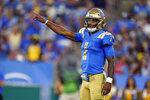 UCLA quarterback Dorian Thompson-Robinson signals during the first half of the team's NCAA college football game against LSU on Saturday, Sept. 4, 2021, in Pasadena, Calif. (AP Photo/Marcio Jose Sanchez)
