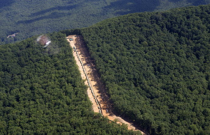 FILE - This July 18, 2018, file photo, shows the Mountain Valley Pipeline route on Brush Mountain in Virginia. The Trump administration is seeking to fast track environmental reviews of the pipeline and dozens of other energy, highway and other infrastructure projects across the U.S. (Heather Rousseau/The Roanoke Times via AP, File)