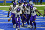 Minnesota Vikings quarterback Kirk Cousins (8) and teammates react after Cousins' touchdown during the second half of an NFL football game against the Detroit Lions, Sunday, Jan. 3, 2021, in Detroit. (AP Photo/Duane Burleson)