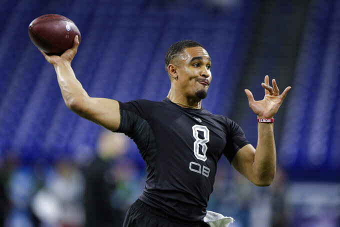 FILE - In this Feb. 27, 2020, file photo, Oklahoma quarterback Jalen Hurts runs a drill at the NFL football scouting combine in Indianapolis. Hurts was selected by the Philadelphia Eagles in the second round of the NFL football draft Friday, April 24, 2020. (AP Photo/Michael Conroy, File)