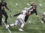 Atlanta Falcons quarterback Matt Ryan throws a touchdown pass to wide receiver Calvin Ridley and is leveled by Las Vegas Raiders defensive tackle Johnathan Hankins during the second quarter of an NFL football game on Sunday, Nov 29, 2020, in Atlanta. (Curtis Compton/Atlanta Journal-Constitution via AP)