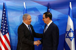 Israeli Prime Minister Benjamin Netanyahu and U.S. Treasury Secretary Steven Mnuchin shake hands as they deliver joint statements during their meeting in Jerusalem, Monday, Oct. 28, 2019. (Ronen Zvulun/Pool Photo via AP)