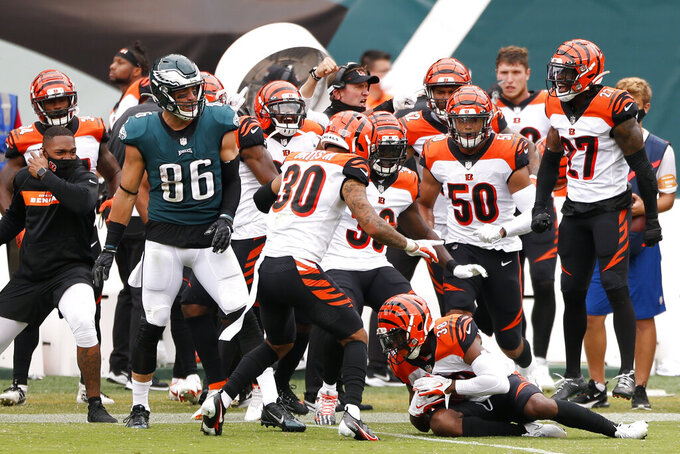 Cincinnati Bengals' LeShaun Sims (38) pulls in an interception from Philadelphia Eagles' Carson Wentz during the second half of an NFL football game, Sunday, Sept. 27, 2020, in Philadelphia. (AP Photo/Laurence Kesterson)