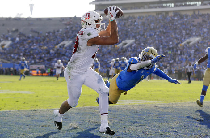 Stanford wide receiver JJ Arcega-Whiteside, left, catches a touchdown next to UCLA defensive back Darnay Holmes (1) during the second half of an NCAA college football game Saturday, Nov. 24, 2018, in Pasadena, Calif. (AP Photo/Marcio Jose Sanchez)