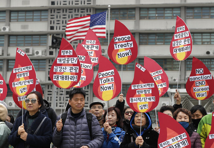 Protesters hold signs during a rally demanding the denuclearization of the Korean Peninsula and peace treaty near the U.S. embassy in Seoul, South Korea, Thursday, March 21, 2019. The Korean Peninsula remains in a technical state of war because the 1950-53 Korean War ended with an armistice, not a peace treaty. More than 20 protesters participated at a rally and also demanding the end the Korean War and to stop the sanction on North Korea. The letters read
