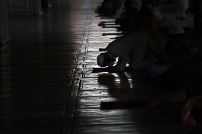 Indian Muslims offer prayers after Jama Mosque opened after lockdown in New Delhi, India, Monday, June 8, 2020. India is reopening its restaurants, shopping malls and religious places in most of its states after a more than 2-month-old lockdown even as the country continues to witness a worrying rise in new coronavirus infections. (AP Photo/Manish Swarup)