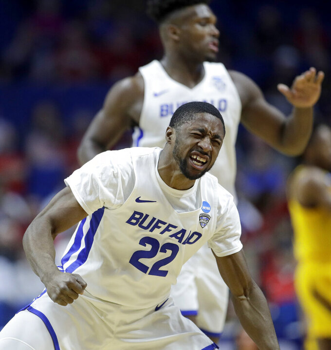Buffalo's Dontay Caruthers celebrates a teammates basket during the first half of a first round men's college basketball game against Arizona in the NCAA Tournament Friday, March 22, 2019, in Tulsa, Okla. (AP Photo/Charlie Riedel)