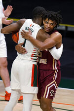 Miami forward Anthony Walker (1) and Boston College guard DeMarr Langford Jr. (15) embrace after Miami defeated Boston College in an NCAA college basketball game Friday, March 5, 2021, in Coral Gables, Fla. (AP Photo/Wilfredo Lee)