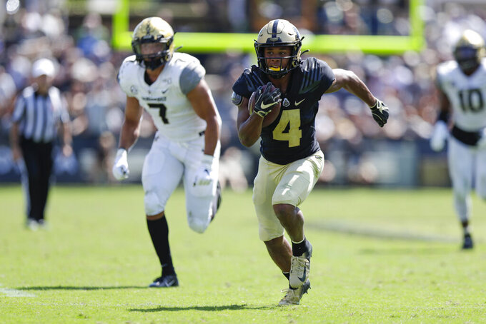 FILE - In this Sept. 7, 2019, file photo, Purdue wide receiver Rondale Moore (4) runs after a catch against Vanderbilt during the second half of an NCAA college football game in West Lafayette, Ind. Moore was selected to The Associated Press preseason All-America first-team, Tuesday, Aug. 25, 2020. (AP Photo/Michael Conroy, File)