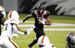 North Carolina State running back Ricky Person Jr. (8) gains yards against Miami during the first half of an NCAA college football game Friday, Nov. 6, 2020, in Raleigh, N.C. (Ethan Hyman/The News & Observer via AP, Pool)