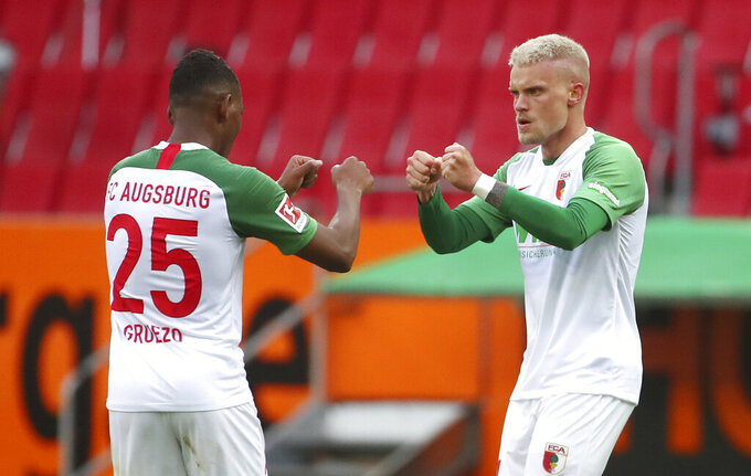 FILE - In this June 7, 2020 file photo, FC Augsburg's Philipp Max celebrates after scoring scoring against 1. FC Cologne in Augsburg, Germany. Germany coach Joachim Loew has called up two debutants for his team's upcoming friendly against the Czech Republic and Nations League games against Ukraine and Spain. Loew named PSV Eindhoven's Philipp Max and Augsburg's Felix Uduokhai, both defenders, in his 29-member squad Friday, when Thilo Kehrer (Paris Saint-Germain), Ilkay Gundogan (Manchester City) and Leroy Sane (Bayern Munich) also returned after missing the October internationals. (Michael Dalder, Pool via AP, FILE)