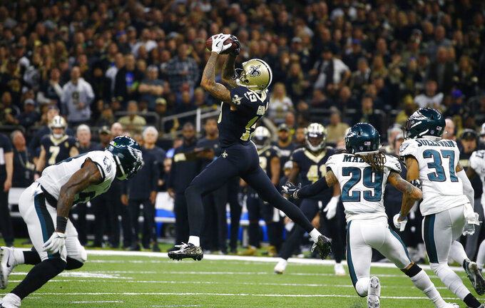 New Orleans Saints wide receiver Ted Ginn (19) pulls in a pass reception in front of Philadelphia Eagles free safety Avonte Maddox (29) and defensive back Tre Sullivan (37) the first half of an NFL divisional playoff football game in New Orleans, Sunday, Jan. 13, 2019. (AP Photo/Butch Dill)