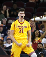FILE - In this March 1, 2017, file photo, Southern California's Nick Rakocevic celebrates his basket during the first half of the team's NCAA college basketball game against Washington State in Los Angeles. Rakocevic is one of the Pac-12's top returning big men. The senior averaged 14.7 points and 9.3 rebounds last season and his 15 double-doubles were second-most in the league. He shot 55 percent from the field, but will need to avoid the foul trouble that plagued him last season. (AP Photo/Jae C. Hong, File)