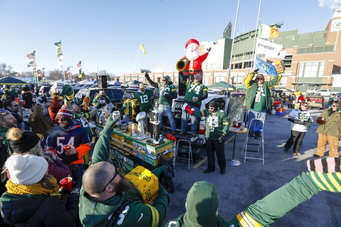 Fans tailgate outside Lambeau Field before an NFL football game between the Green Bay Packers and the Chicago Bears Sunday, Dec. 15, 2019, in Green Bay, Wis. (AP Photo/Mike Roemer)