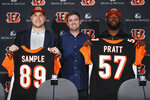 From left, Cincinnati Bengals football second round NFL draft pick Drew Sample, head coach Zac Taylor, and third round draft pick Germaine Pratt pose for a photograph during a news conference at Paul Brown Stadium, Saturday, April 27, 2019, in Cincinnati. (AP Photo/John Minchillo)