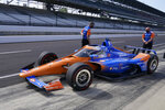 Scott Dixon, of New Zealand, leaves the pits during practice for the Indianapolis 500 auto race at Indianapolis Motor Speedway, Friday, May 21, 2021, in Indianapolis. (AP Photo/Darron Cummings)