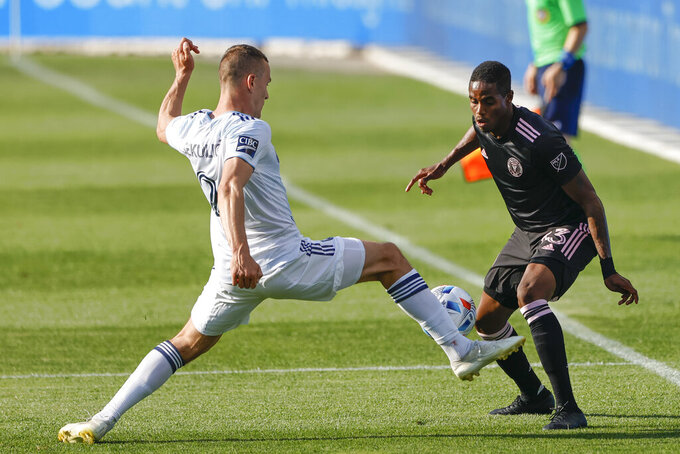 Chicago Fire defender Boris Sekulic (2) closes in on Inter Miami defender Joevin Jones (33) during the first half of an MLS soccer match, Saturday, May 22, 2021, in Chicago. (AP Photo/Kamil Krzaczynski)