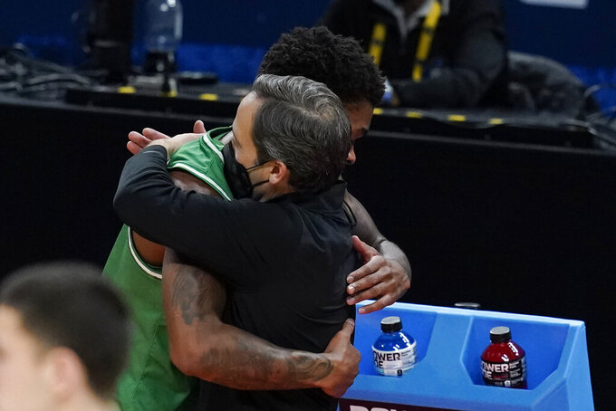 North Texas head coach Grant McCasland hugs Javion Hamlet during the second half of a second-round game against Villanova in the NCAA men's college basketball tournament at Bankers Life Fieldhouse, Sunday, March 21, 2021, in Indianapolis. Villanova won 84-61. (AP Photo/Darron Cummings)