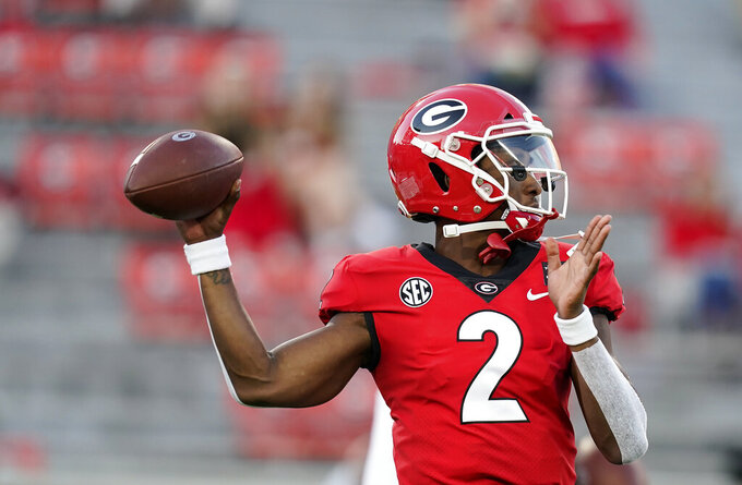 Georgia quarterback D'Wan Mathis warms up for the team's NCAA college football game against Auburn, Saturday, Oct. 3, 2020, in Athens, Ga. (AP Photo/Brynn Anderson)