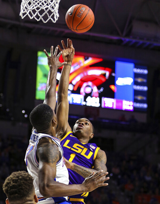 LSU guard Javonte Smart (1) shoots over Florida center Kevarrius Hayes (13) during overtime in an NCAA college basketball game in Gainesville, Fla., Wednesday, March 6, 2019. (AP Photo/Gary McCullough)