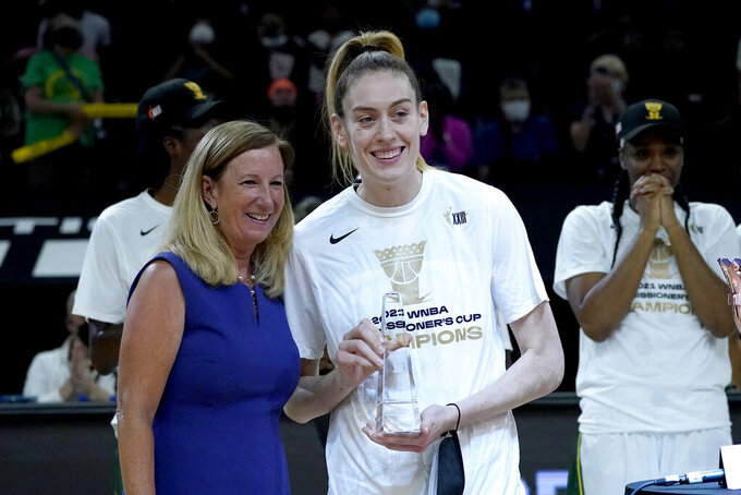 Seattle Storm forward Breanna Stewart holds the MVP trophy after the Commissioner's Cup WNBA basketball game against the Connecticut Sun, Thursday, Aug. 12, 2021, in Phoenix. (AP Photo/Matt York)