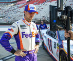 Denny Hamlin watches a television monitor as the last car qualifies for the NASCAR Cup Series auto race, Friday, Aug. 16, 2019, at Bristol Motor Speedway in Bristol, Tenn. Hamlin won the pole for Saturday night's race. (David Crigger/Bristol Herald Courier via AP)