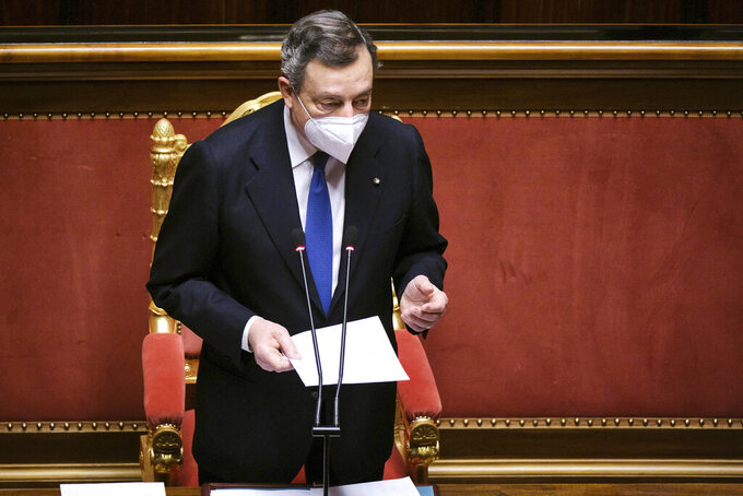 Italian Premier Mario Draghi wears a face mask to curb the spread of COVID-19 as he addresses the Senate ahead of the European Council of March 25-26, in Rome, Wednesday, March 24, 2021. Draghi on Wednesday decried that various interest groups are getting their members COVID-19 vaccines before adults older than 80 receive the shots. (Mauro Scrobogna/LaPresse via AP)