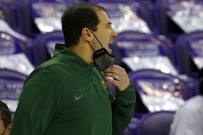 Baylor head coach Scott Drew reacts during an NCAA college basketball game against TCU, Saturday, Jan. 9, 2021, in Fort Worth, Texas. (AP Photo/ Richard W. Rodriguez)